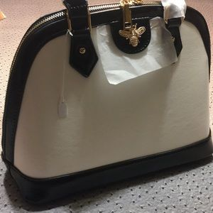 Brand new small white and black purse